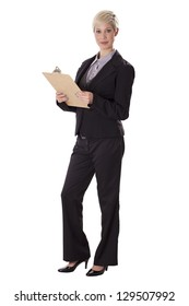 Female business professional in a pant suit stands with a clipboard.