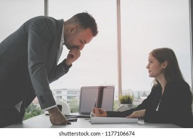 Female business is showing her boss the business plan