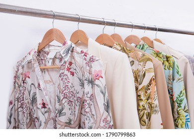 female business suit formal jacket and floral ,palm pattern summer dress ,blouse,clothes,dress on hanger