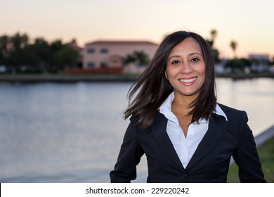 Female business woman head shot outdoors