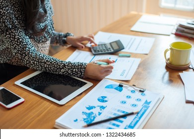 Female businessmen are calculating taxes from the profits of the company. Creditors are calculating and writing invoices to their debtors. Women are calculating about her expenses and liabilities.