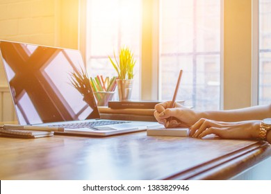 Female businessmen are checking the property accounts and annual sales to summarize the results. Businessmen are summarizing sales to close the annual budget alone near the window in the morning.