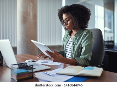 Female businesswoman analyzing the business report in the office