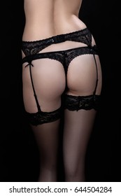 female buttocks and feet in lingerie and stockings