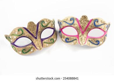 Female carnival masks on white background