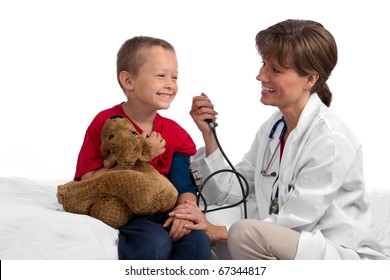 Female caucasian doctor giving a cute blond boy a physical, checking his blood pressure, both happy