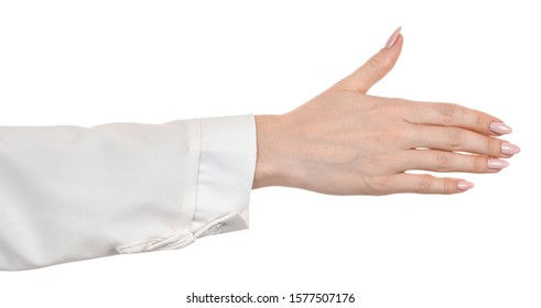 Female caucasian hands in a white office blouse, shirt isolated white background showing handshake gesture. welcomed.  woman hands in business office style showing different gestures