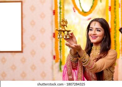 Female Celebratiing diyas Decoration  for diwali festival.