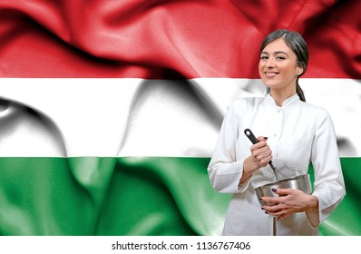 Female chef against national flag of Hungary
