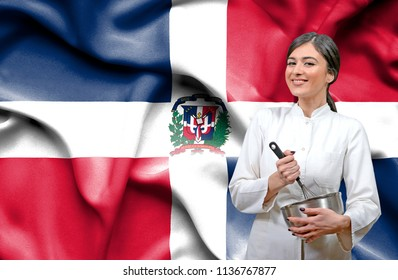 Female chef against national flag of Dominican Republic