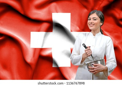 Female chef against national flag of Swiss