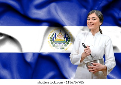 Female chef against national flag of El Salvador