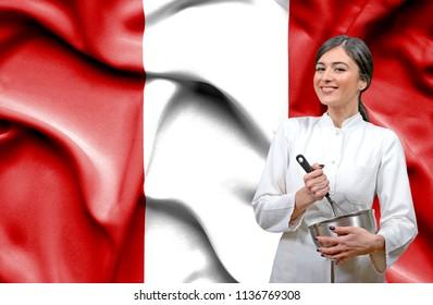 Female chef against national flag of Peru