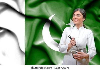 Female chef against national flag of Pakistan