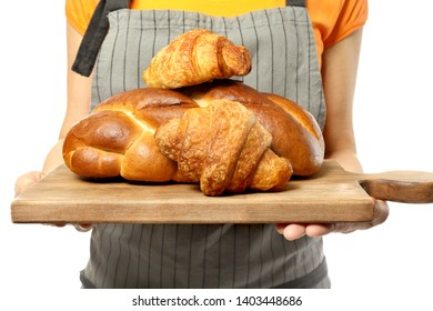 Female chef with bakery products on white background, closeup