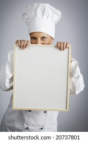 female  chef holding menu board