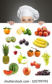 Female chef looking over fruit collection billboard