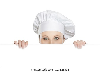 Female chef looking over paper sign billboard