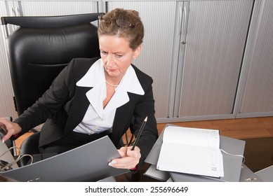 female chef in the office with a lot of files
