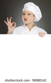 Female chef showing positive gesture with blank copy space