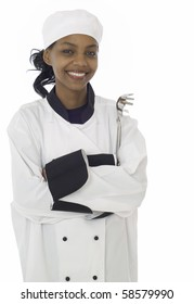 Female chef in work uniform with cooking utensil