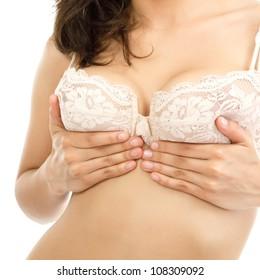 female chest in bra close up, white background