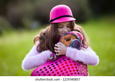 Female child hugging her teddy bear