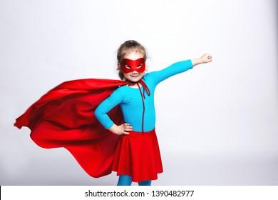 Female child in superhero costume. Strong free girl.