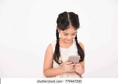 Female child using smart phone on white background