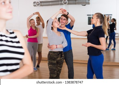 female choreographer teaches children to dance in the hall