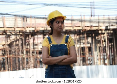 Female civil engineer or architect with yellow helmet