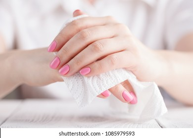 Female cleaning his hand with tissue on white background