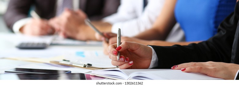 Female clerk arm make marks in notepad with silver pen closeup at office workplace. Audit paperwork financial inspector assistant fill survey form for job offer management training course discussion