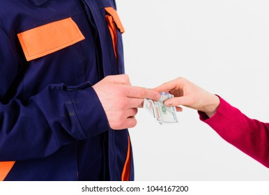 Female client pay to repairman, money in hands isolated on white background. Customer give money to repairman, builder. Repairer, builder get salary for work, close up. Payday and payment concept.
