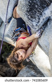 Female climber ascends with determination, strength and beauty.