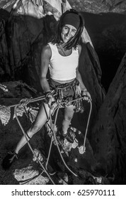 Female climber belaying on the summit.