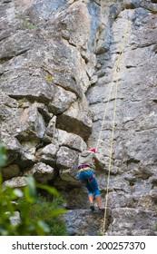Female climber on a rock