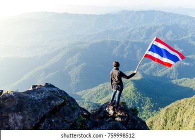 Female climber Standing Flag of Thailand, at Doi Luang Chiang Dao Chiang Mai Thailand