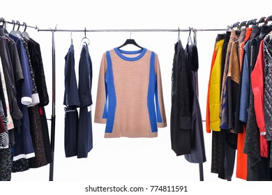 female clothes of different colors on hangers