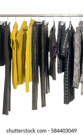 female clothes of different sundress, coat, on hangers