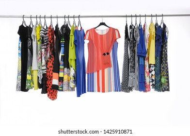 female clothes dresses with different floral pattern sundress on hangers