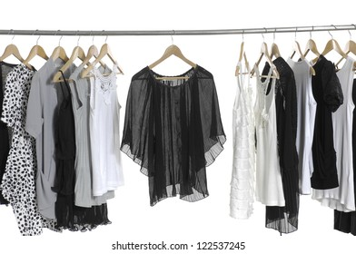 Female clothes hanging on the rack