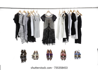 female clothes hanging with shoe-on white background