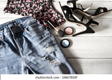 Female clothes, high heels and accessories on floor