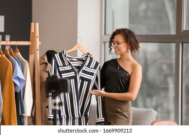 Female clothes stylist working in office