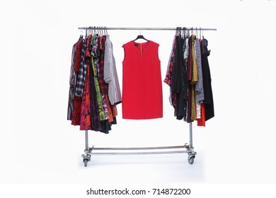 female clothing hanging on hangers