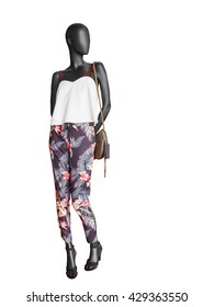 Female clothing on a mannequin with handbag on white background. No brand names or copyright objects.
