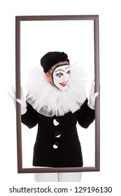 female clown in a frame is looking angry