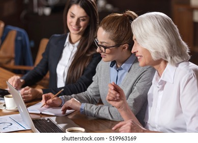 Female colleagues having brainstorming about work