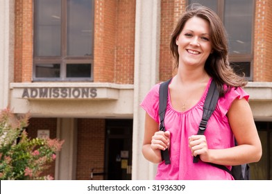 Female college student with backpack leaving admissions office at university.
